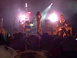 The Darkness on stage on Looe beach.