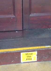 As an old building, going in there is a sign for people to mind the step.